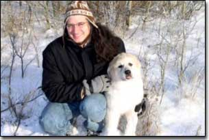 Darren puppy and Great Pyrenees-Solomon in winter