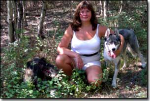 Husky-Isis with Barbara in a forest