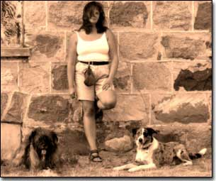 Briard-Artemis and Border Collie and Barbara leaning against Nicole homestead