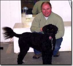 Owner and his Portugese water dog