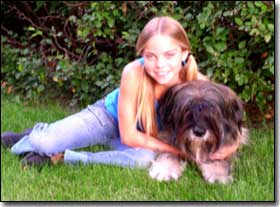 Briard-Artemis with Co-Star Emily laying on grass
